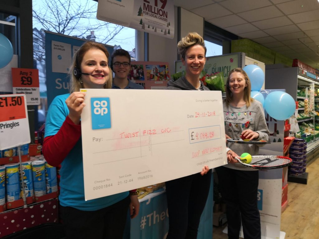Twistfizz team awarded grant cheque by New Eltham Coop store manager