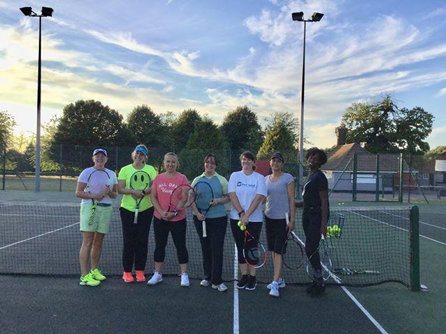 Women play tennis on Tuesday evening